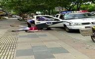 رفتار زشت پلیس چین با یک مادر بخاطر پارکینگ! +تصاویر