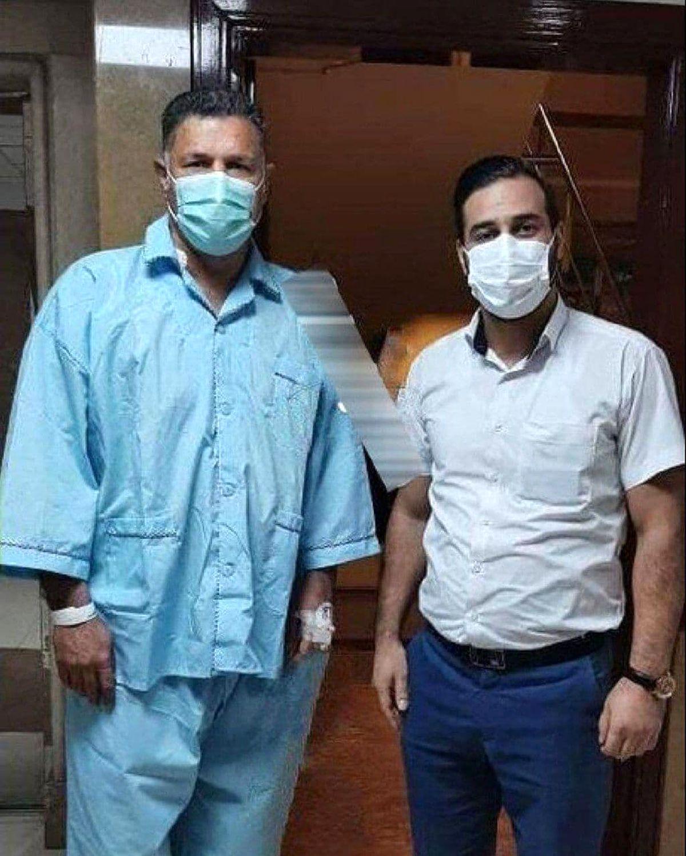 علت اصلی بستری شدن علی دایی در بیمارستان | لحظه ضربه دردناک دروازهبان بحرینی به شکم دایی +عکس